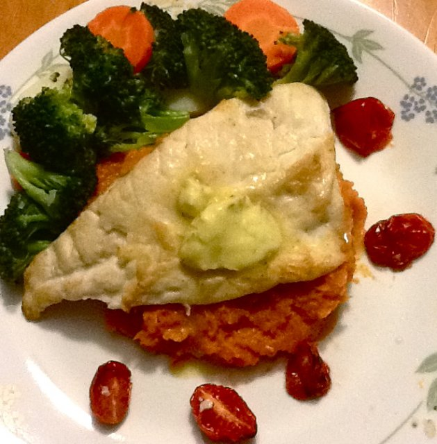 Snapper, topped with lemon butter on a bed of mashed sweet potato, steamed veg and roast tomatoes