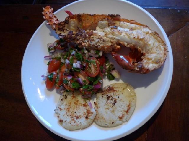 BBQ Crayfish halves with Olive & Tomato Salad and fried Potatos