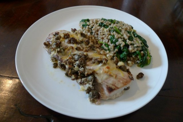 Dolly baked with parmesan, capers and lemon rind, served with buckwheat and spinach.