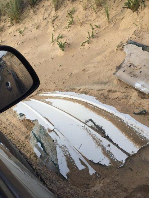 fibreglass hull remains, buffalo beach,