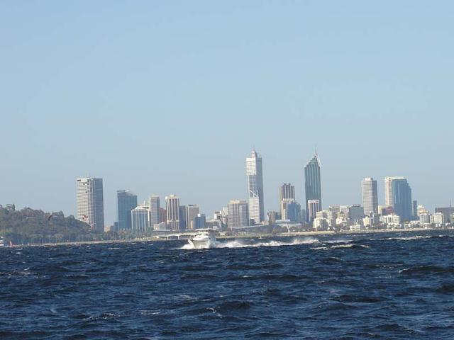 Perth City and a big boat in foreground.